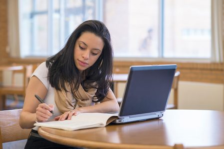 Elysia Fernandez-Ruiz, a BYU-Idaho student, studies hard at the library.