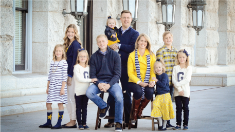 Newly called President Gilbert with his wife, Christine, and eight children