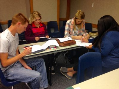 Student in Glendale, Arizona provide feedback to each other during a gathering.