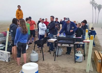 Julie's ward jumping in to help serve breakfast on the beach.