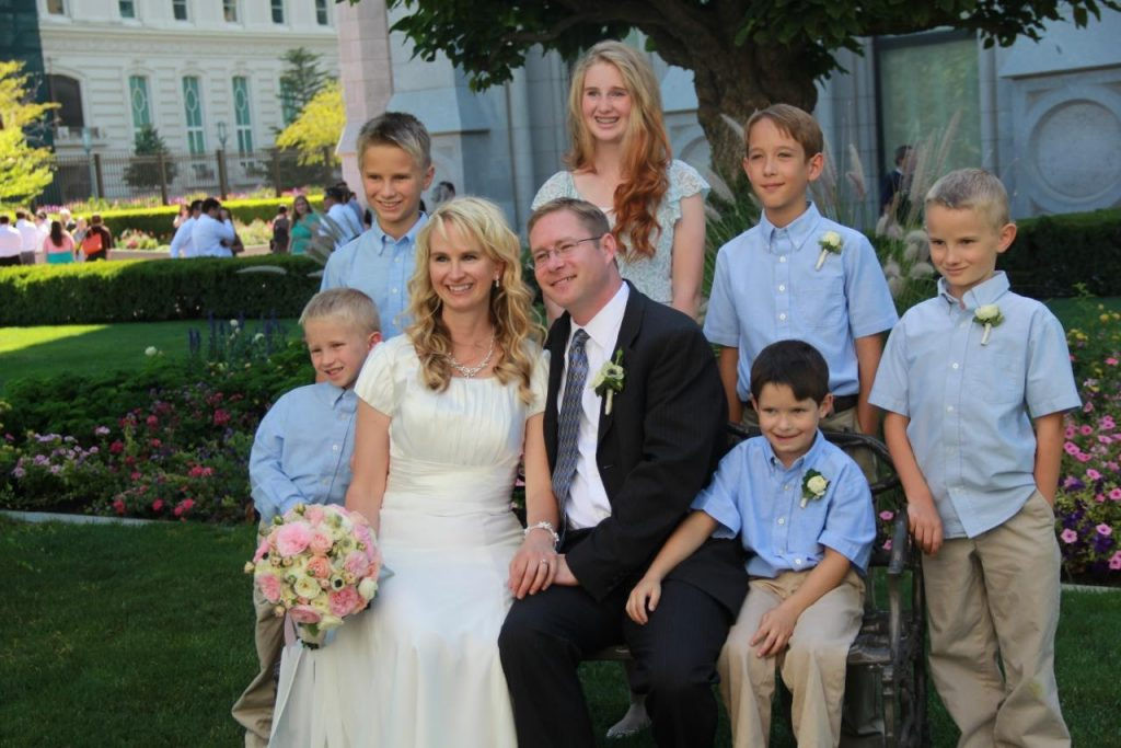 Alisa and Randall with their children on their wedding day.