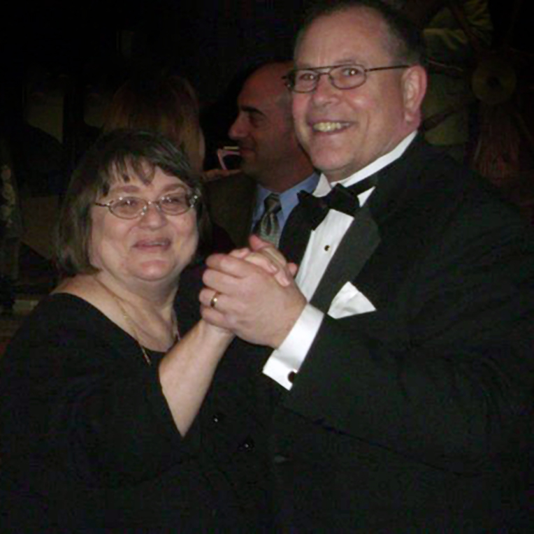 Elder Nielsen and his wife, Mary, dancing at a party for Elder Nielsen's work