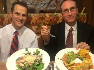 Joseph and Doug eating dinner