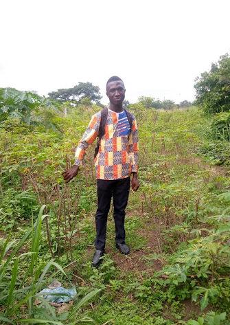 standing in his garden